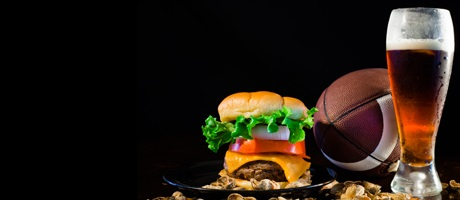 Cheesburger, a football, and a draft beer